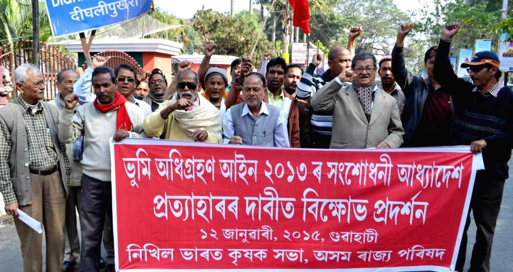 Activists of All India Krishak Sabha (AIKS) stage a protest against recent amendments to the land acquisition act, made through an ordinance, in Guwahati on Jan 12, 2015.