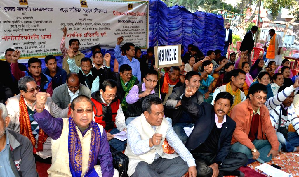 Activists of Bodo Sahitya Sabha ABSU,ABWWF,ABPTA and other organisations stahe a demonstration against the recent Assam violence in which 73 people were killed, in Guwahati on Dec 28, 2014.