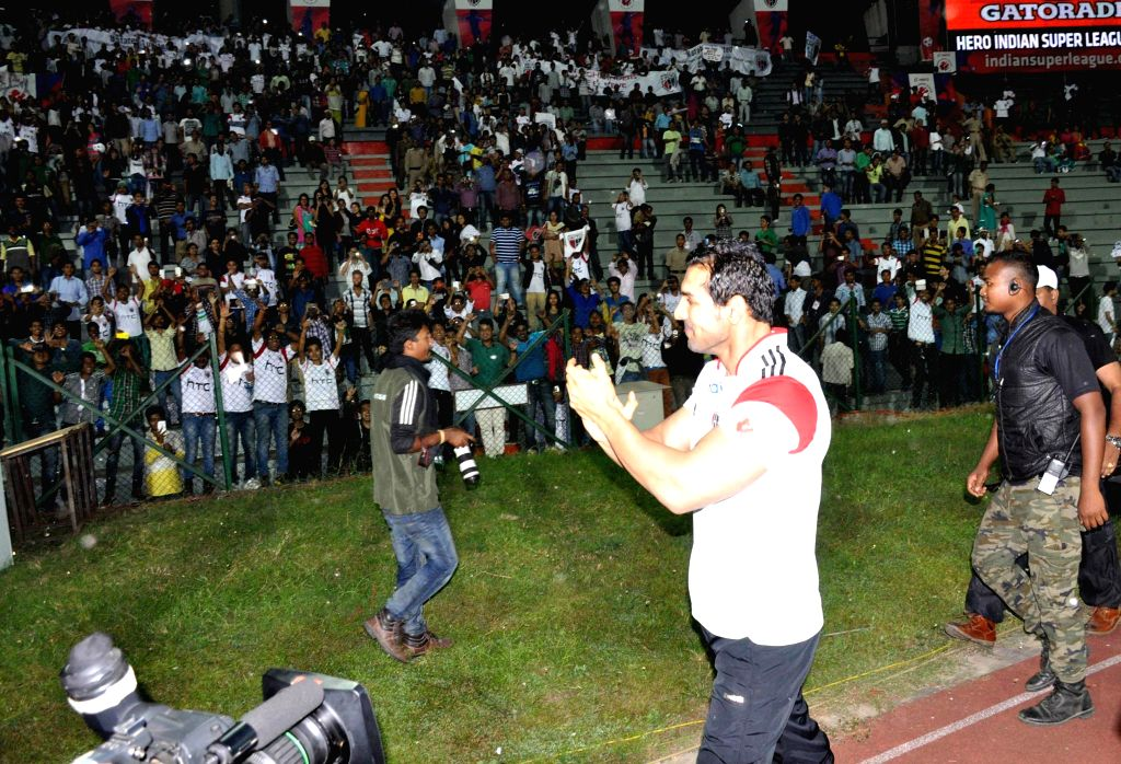 Actor and co-owner of North East United FC John Abraham cheering the crowd before the match against FC Pune City in the Indian Super League, at Indira Gandhi Athletic Stadium in Guwahati on