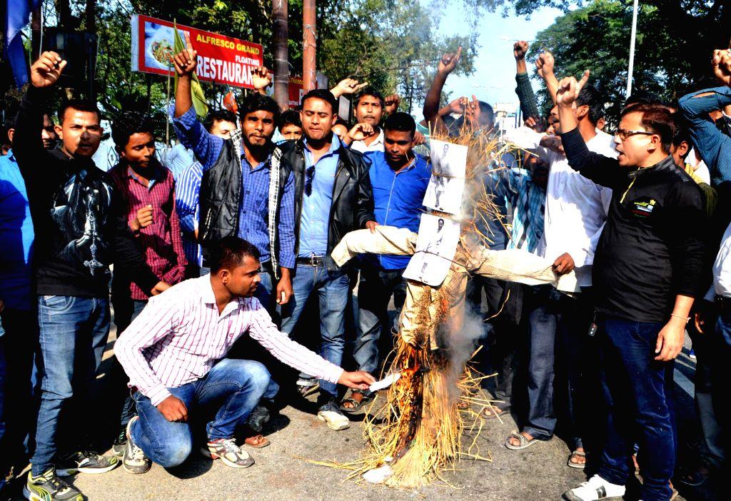 All Assam Gariya Yuva Chatra Parishad stage a demonstration against Assam Chief Minister Tarun Gogoi in Guwahati on Dec 4, 2014. - Tarun Gogoi