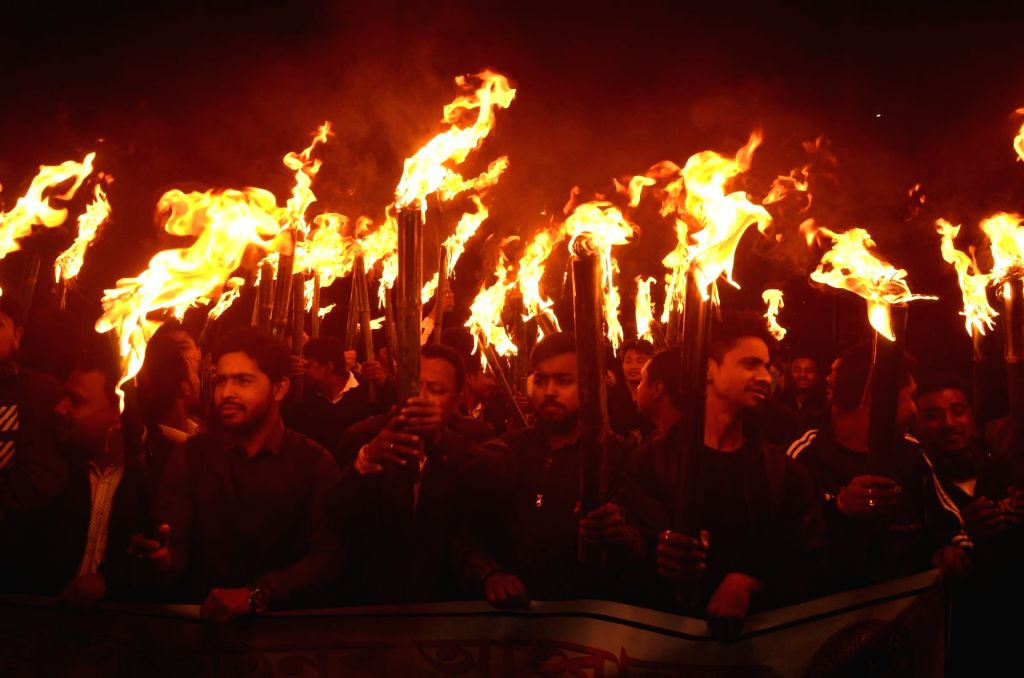 Guwahati: All Assam Students Union (AASU) activists participate in a torch light rally to protest against Citizenship (Amendment) Bill in Guwahati, on Jan 31, 2019. (Photo: IANS)