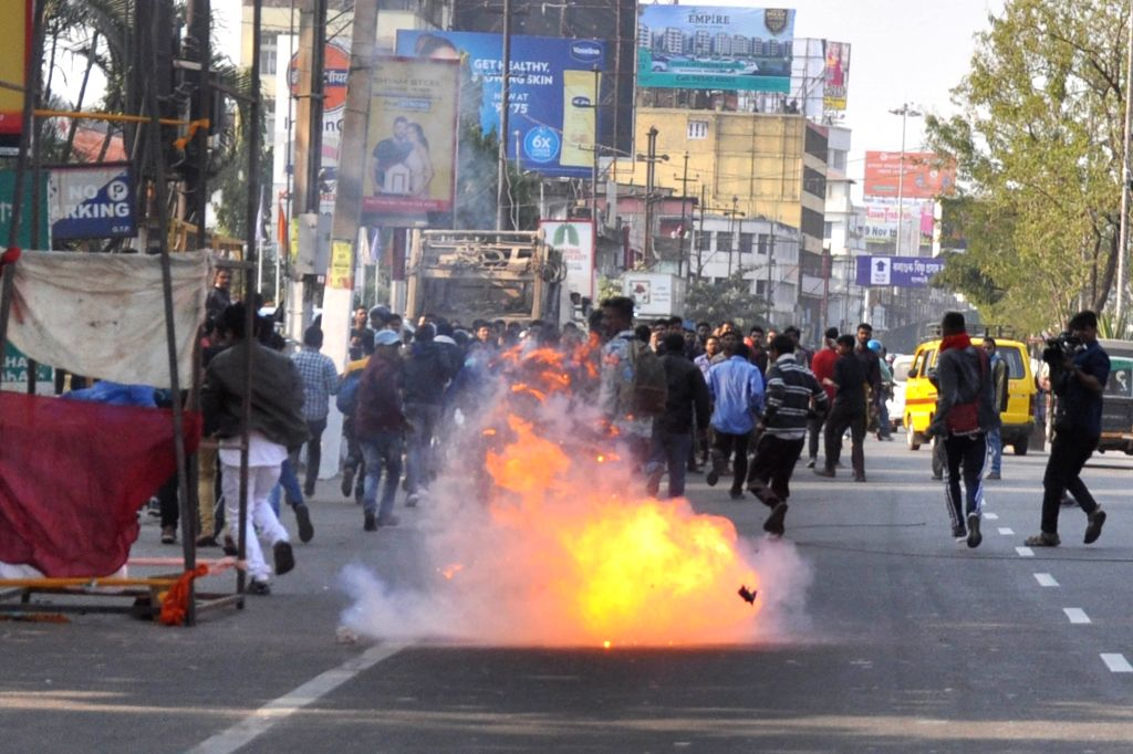 Guwahati: Angry protestants go on rampage while protesting against the Citizenship (Amendment) Bill 2019 that was tabled in the Rajya Sabha today, demanding unconditional withdrawal of the contentious bill, in Guwahati on Dec 11, 2019. The protesters