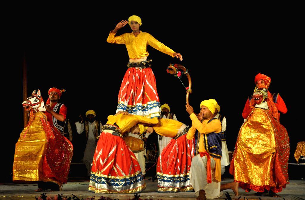 Artists performs during Dharohar, a festival of folk traditions of Uttar Pradesh, organised by Sangeet Natak Akademi, New Delhi and Sonchiraiya, Lucknow at Srimanta Sankardeva Kalakhetra in ...
