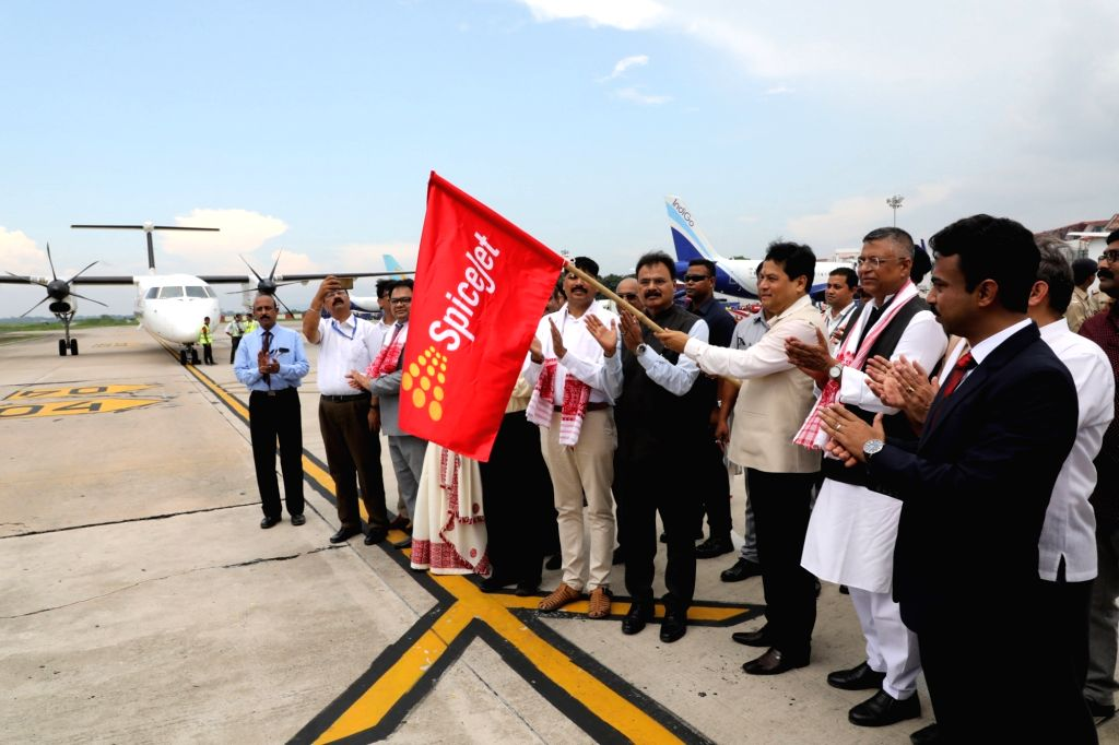 Guwahati: Assam Chief Minister Sarbananda Sonowal flags off the first international daily direct flight between Guwahati and Dhaka 'SG 78', launched by SpiceJet at the Lokapriya Gopinath Bordoloi International Airport, in Guwaha - Sarbananda Sonowal