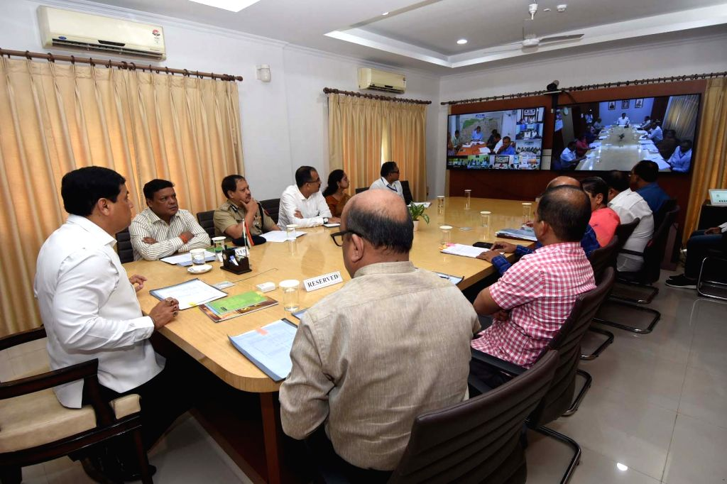 Guwahati: Assam Chief Minister Sarbananda Sonowal reviews the flood situation in the state during a meeting in Guwahati, on July 11, 2019. With flood waters inundating over 700 villages in 17 districts and affecting over 4 lakh people in the state, S - Sarbananda Sonowal