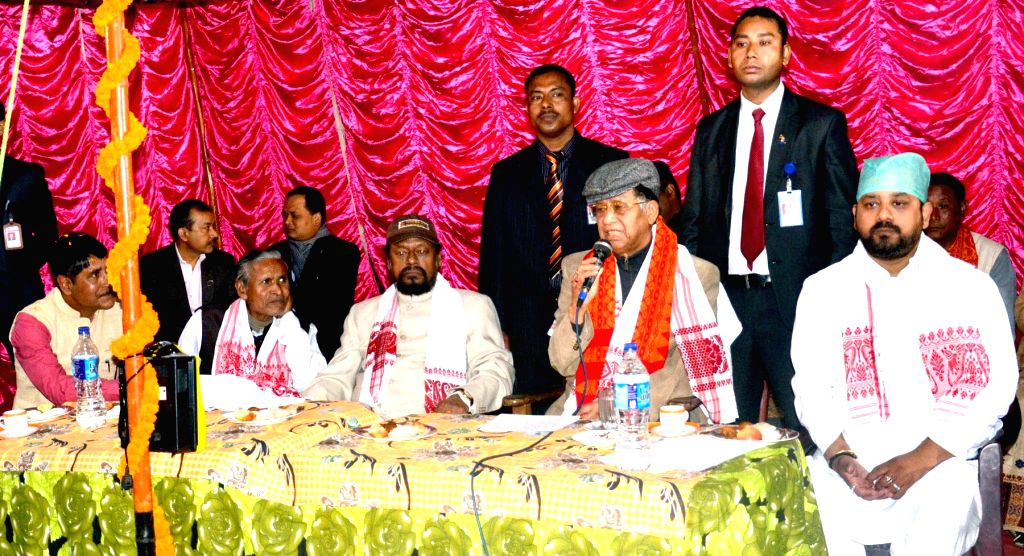 Assam Chief Minister Tarun Gogoi addresses during a programme organised on Bhogali Bihu in Sonapur of  Guwahati on Jan 14, 2015. - Tarun Gogoi