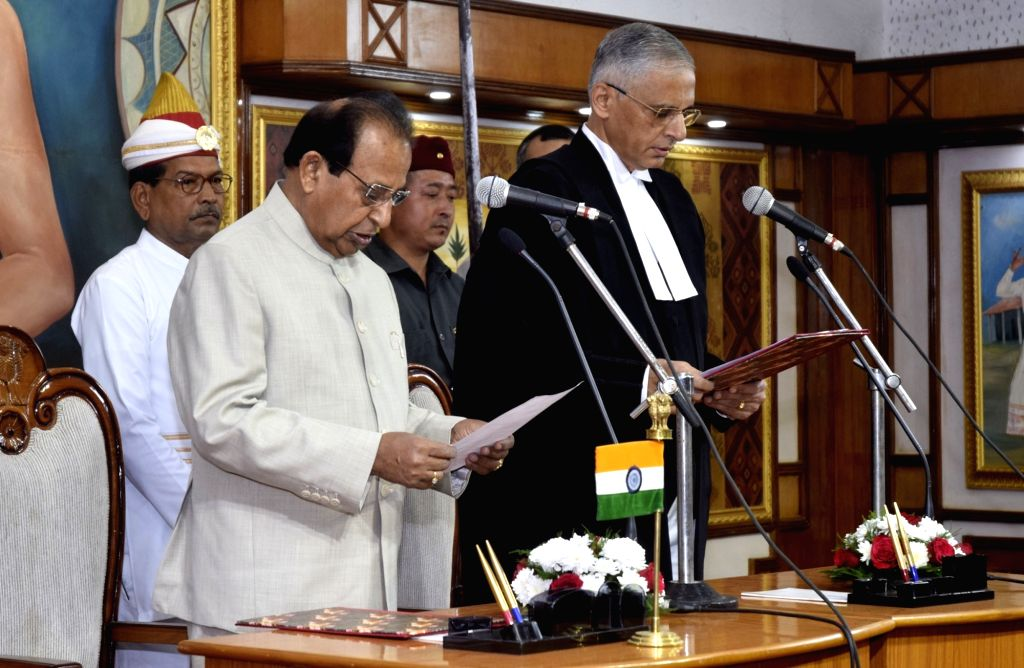 : Guwahati: Assam Governor Jagdish Mukhi administers the oath of office to Justice Ajjikuttira Somaiah Bopanna, as the new Chief Justice of Gauhati High Court at Raj Bhavan in Guwahati on Oct 29, ...
