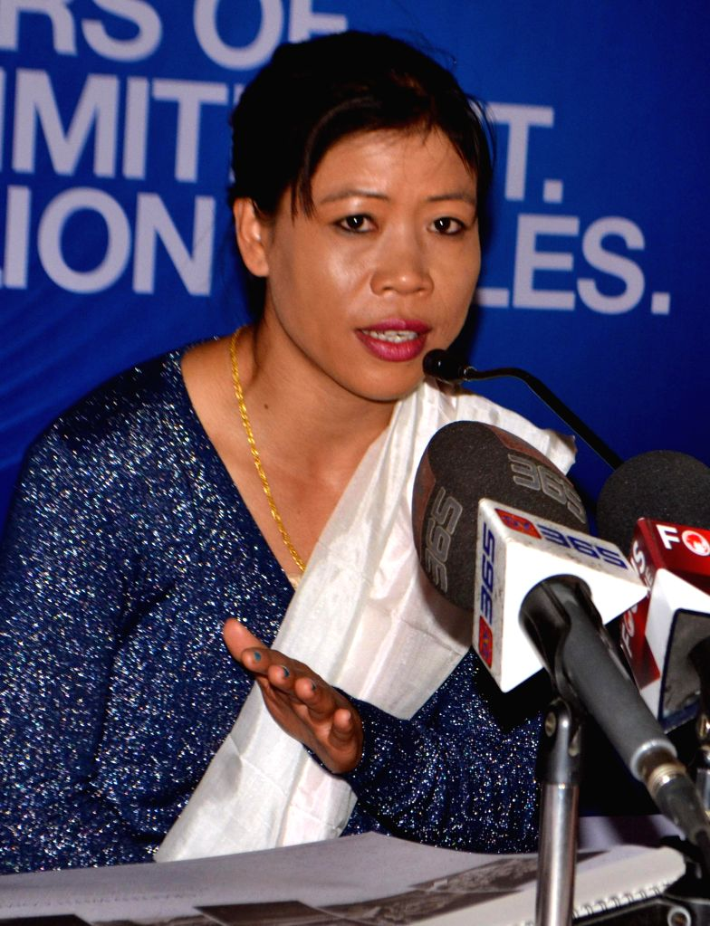 Boxer M.C. Mary Kom addresses during the release of a 2015 calender in Guwahati on Jan 12, 2015.