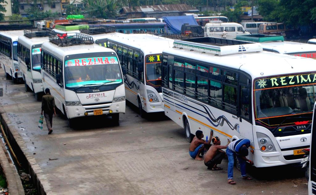 Buses remain parked at a Guwahati bus depot during a 24-hour nationwide transport strike called by trade unions on April 30, 2015.