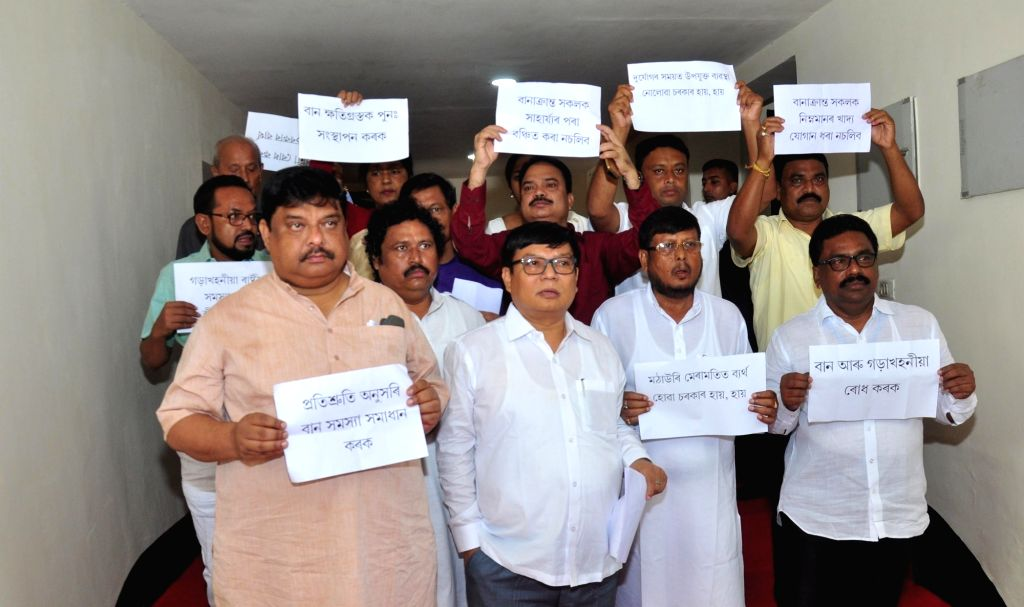 Guwahati: Congress MLAs stage a demonstration over flood situation in Assam, at the state assembly in Guwahati on July 26, 2019. With the death of five more persons in the last 24 hours, the death toll of in the Assam flood rose to 80. More than 27 l