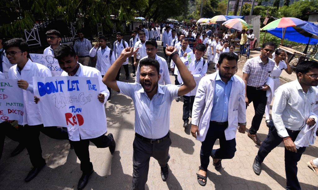 Guwahati: Doctors participate in a protest rally demanding immediate justice for senior doctor Deben Dutta who was thrashed to death, in Guwahati on Sep 3, 2019. The Ministry of Health and Family Welfare has proposed a legislation to address the issu