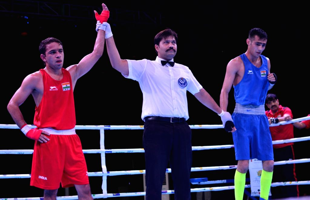 Guwahati: India's Amit Panghal (Red) after winning against Sachin Siwach of India during the India Open International Boxing Tournament 2019 at Nabin Chandra Bordoloi Stadium in Guwahati on May 24, 2019. (Photo: IANS)