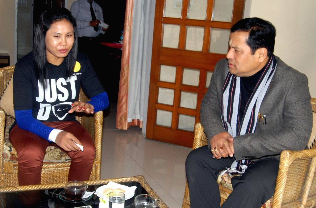 Indian boxer L Sarita Devi meets Union Minister of State for Sports and Youth Affairs Sarbananda Sonowal in Guwahati on Jan 3, 2015.