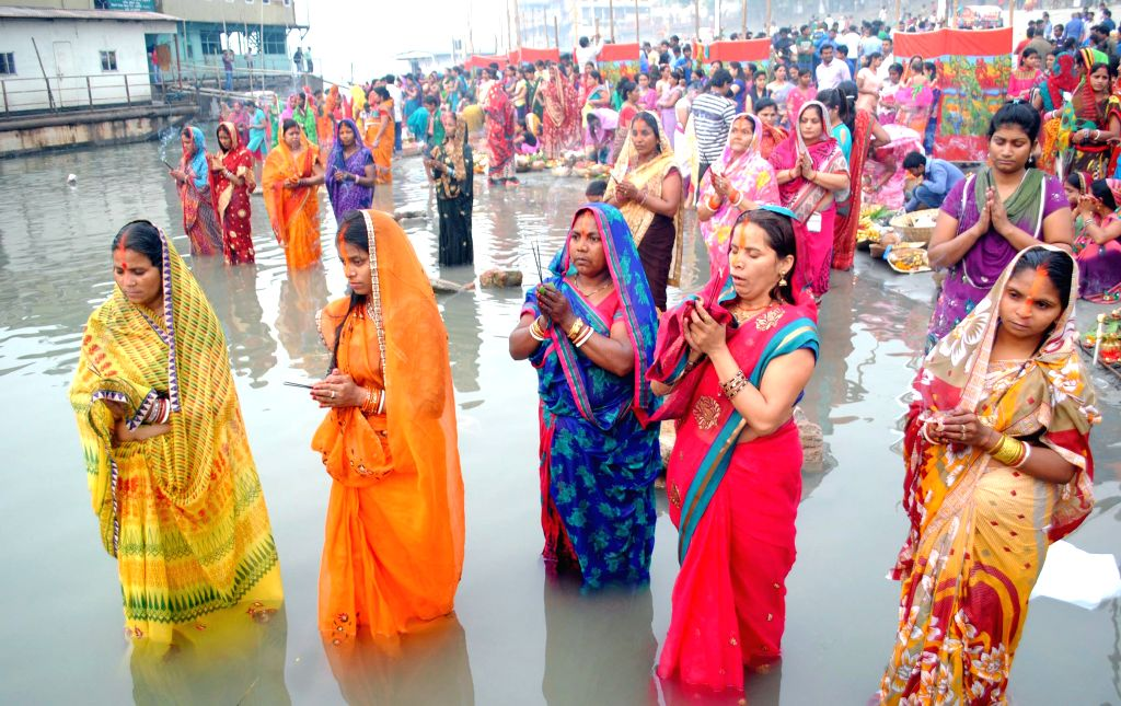 People celebrate Chaitya Chhath on the banks of Brahmaputra River in Guwahati, on March 25, 2015.