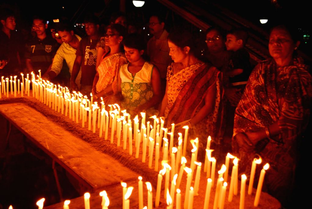 People pay tribute to the victims of Nepal earthquake in Guwahati, on April 30, 2015.