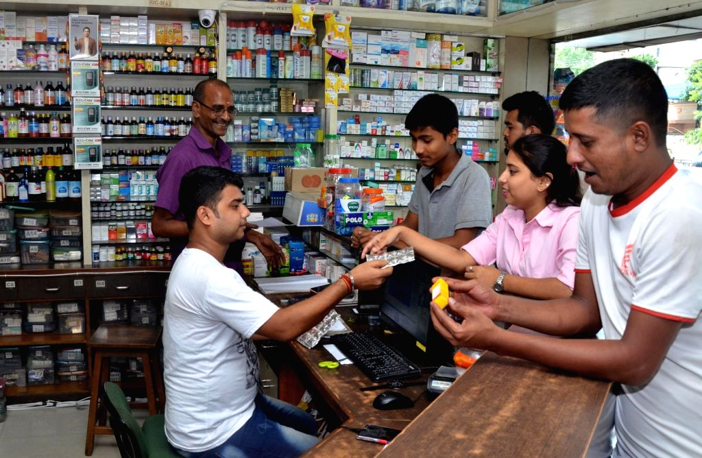 Guwahati: People purchase medicines from a medical store, in Guwahati on July 5, 2019. Achieving a healthy society via Ayushman Bharat, well-nourished women and children and safety of citizens is one of the key highlights of the Union Budget 2019 pre - Nirmala Sitharaman