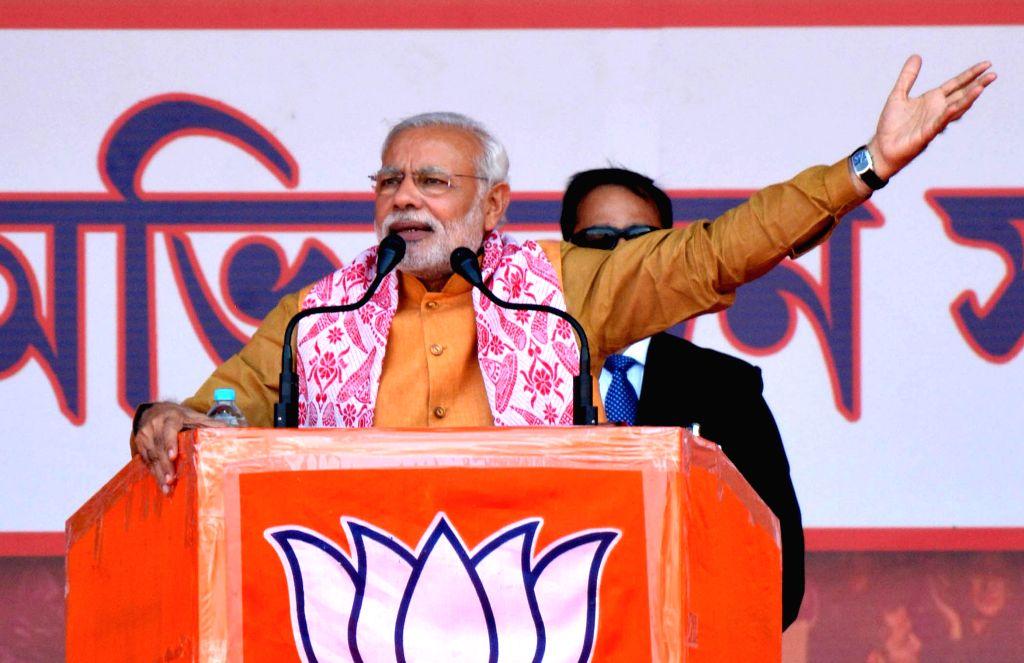 Prime Minister Narendra Modi addresses during a BJP meeting at Indira Gandhi Athletic Stadium in Guwahati on Nov 30, 2014. - Narendra Modi