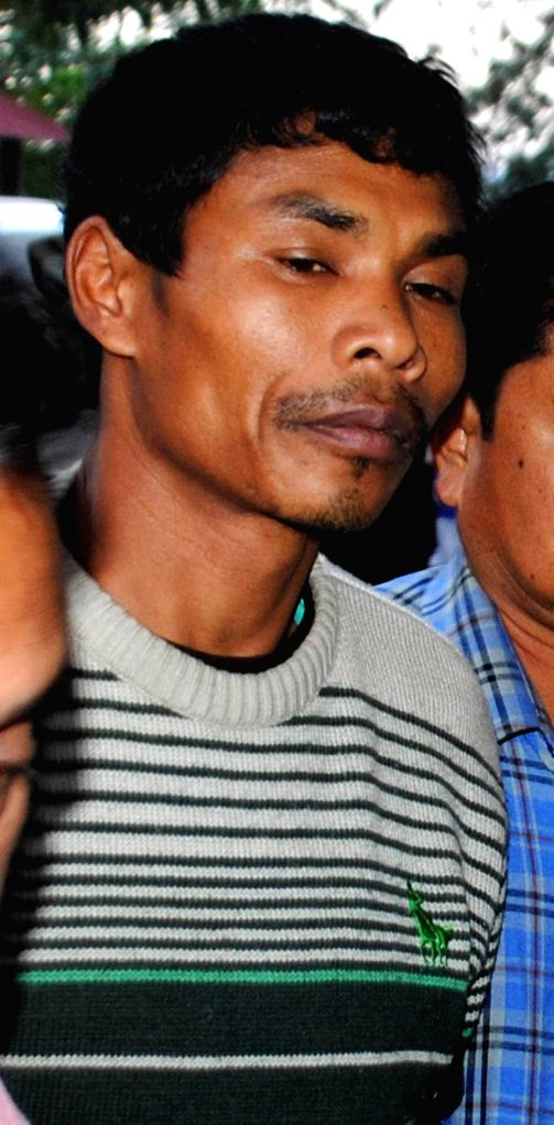Senior Commander of the 3rd Battalion of NDFB (S) Ajoi Basumatary alias B. Bhhum being taken to be produced at a Guwahati court on Jan 16, 2015. He was arrested from Kohima by National ...