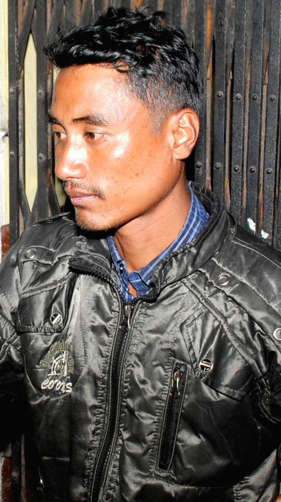 Senior Forest Secretary of NDFB (S) Dilip Basumatary alias Bir Baisa being taken to be produced at a Guwahati court on Jan 16, 2015. He was arrested from Kohima by National Investigation ...
