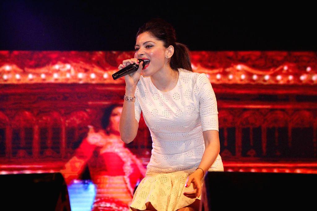 Singer Kanika Kapoor performs during a programme at Indira Gandhi Athletic Stadium in Guwahati, on May 4, 2015.
