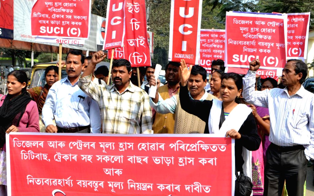 SUCI activists stage a demonstration to press for reduction in bus fares in Guwahati, on Feb 11, 2015.