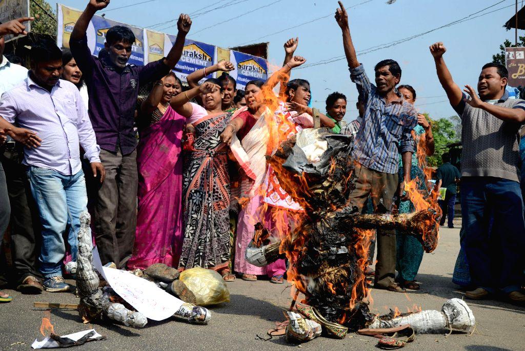The activists of All Krishak Mukti Sangram Samity (KMSS) burn effigies of Prime Minister Narendra Modi and BJP president Amit Shah as BJP's vision document for the Delhi assembly polls ... - Narendra Modi and Amit Shah