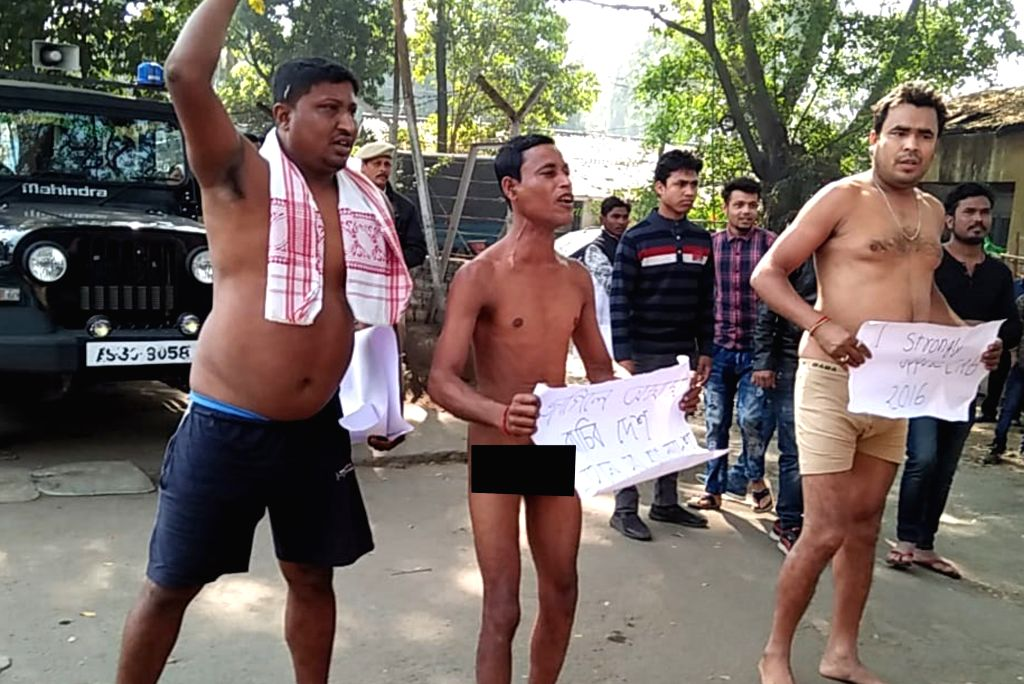 Guwahati: Three men stage a nude protest near the Assam Secretariat in protest against the Citizenship (Amendment) Bill in Guwahati on Feb 1, 2019. The protesters were swiftly removed by security personnel. Protests against the Bill have enveloped vi