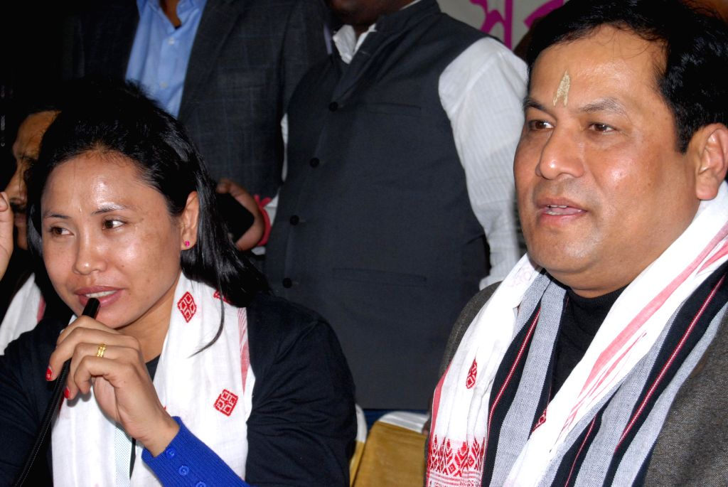 Union Minister of State for Sports and Youth Affairs Sarbananda Sonowal with Indian boxer L Sarita Devi address a press conference during an interactation event in Guwahati on Jan 3, 2015.