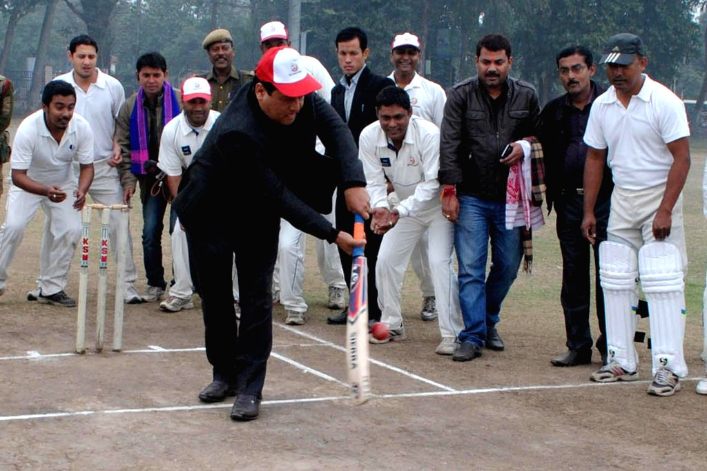 Union Minister of State for Youth Affairs and Sports (Independent Charge) Sarbananda Sonowal tries his hands at batting at the inauguration of TG Baruah Memorial Media T-20 Cricket ...