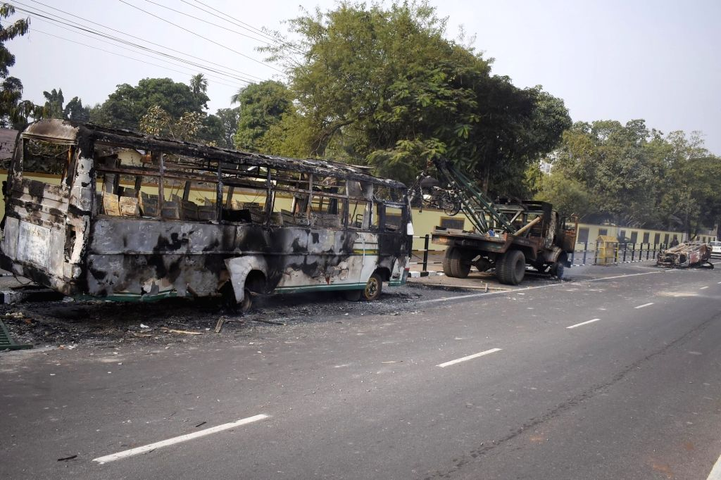 Guwahati: Vehicles that were set ablaze by angry protesters during their demonstration against the Citizenship (Amendment) Bill 2019, in Guwahati on Dec 12, 2019. (Photo: IANS)