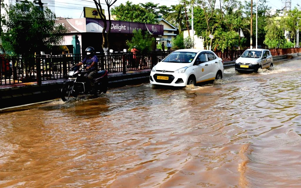 Guwahati: Vehicles wade through a water-logged road after heavy rains lashed Guwahati, on May 26, 2020. (Photo: IANS)