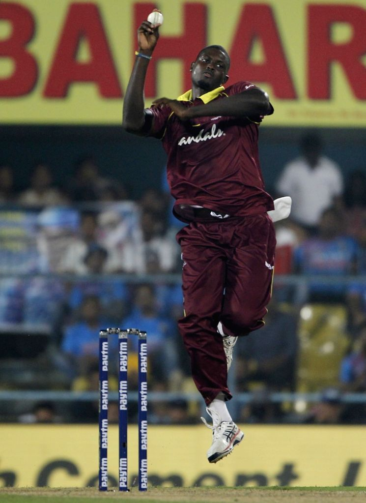 :Guwahati: West Indies captain Jason Holder in action during the first ODI (One Day International) match between India and West Indies at the Barsapara Cricket Stadium in Guwahati, on Oct 21, 2018. ...