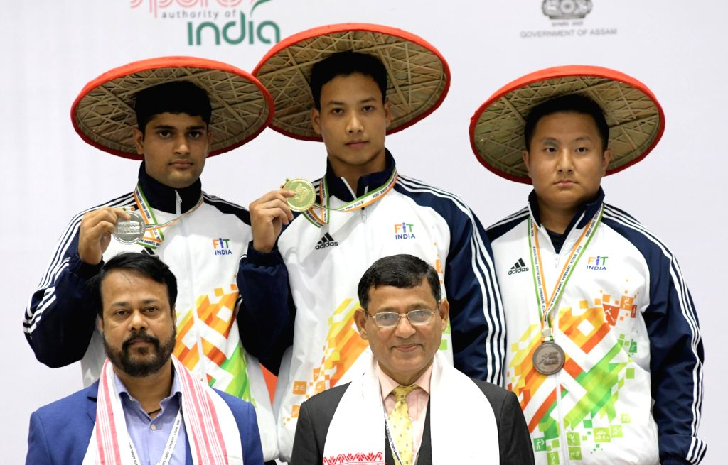 Guwahati: Winners of Weightlifting Boys Under 21 in 81kg category - Gulap Gogoi from Assam bagged Gold, Ankush Kumar from Uttar Pradesh bagged Silver and Premba Tshering Sherpa from Sikkim clinched Bronze at the third edition of Khelo India Youth Gam - Ankush Kumar