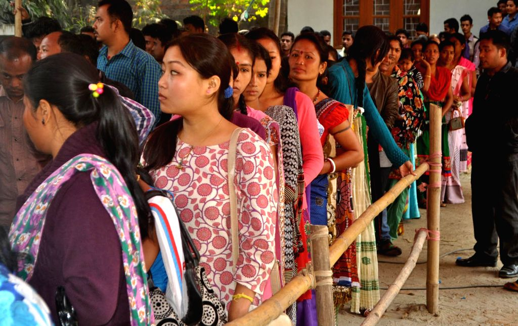 Youth Congress activists queue-up to cast their vote during administrative election of Assam Youth Congress at Manabendra Sarma complex in Guwahati on Dec 5, 2014.