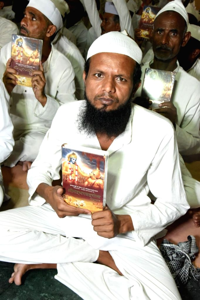Gwalior: Akeel Pathan, a Gwalior jail inmate with a copy of Shrimad Bhagwat Geeta during a Geeta distribution programmne organised at the prison, on Oct 8, 2019. (Photo: IANS)