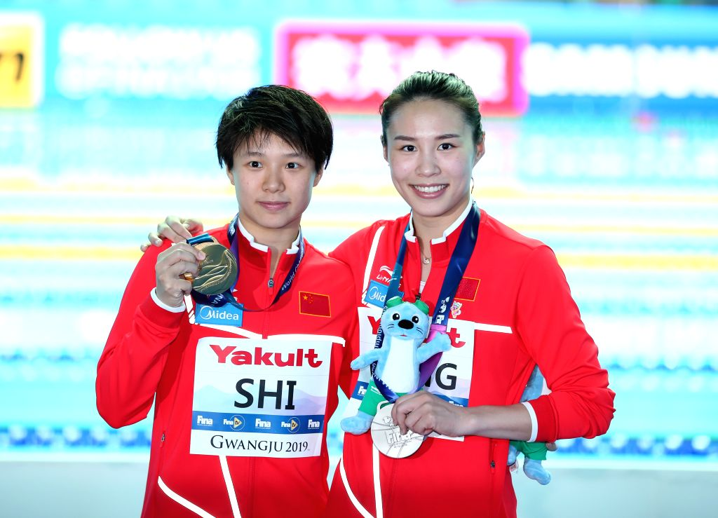 GWANGJU, July 19, 2019 - Gold medalist Shi Tingmao (L) and silver medalist Wang Han of China pose for photos after the women's 3m springboard final of diving event at FINA World Championships in ...