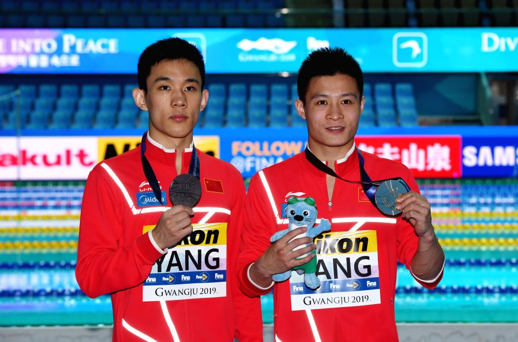 GWANGJU, July 20, 2019 - Gold medalist Yang Jian (R), silver medalist Yang Hao of China pose after the medal ceremony of the men's 10m platform of diving event at the Gwangju 2019 FINA World ...