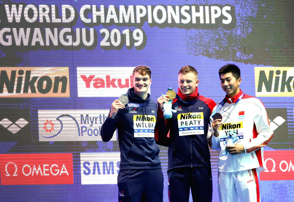 GWANGJU, July 22, 2019 - Bronze medalist Yan Zibei (R) of China, gold medalist Adam Peaty (C) of Britain and silver medalist James Wilby of Britain pose for photos during the awarding ceremony of the ...