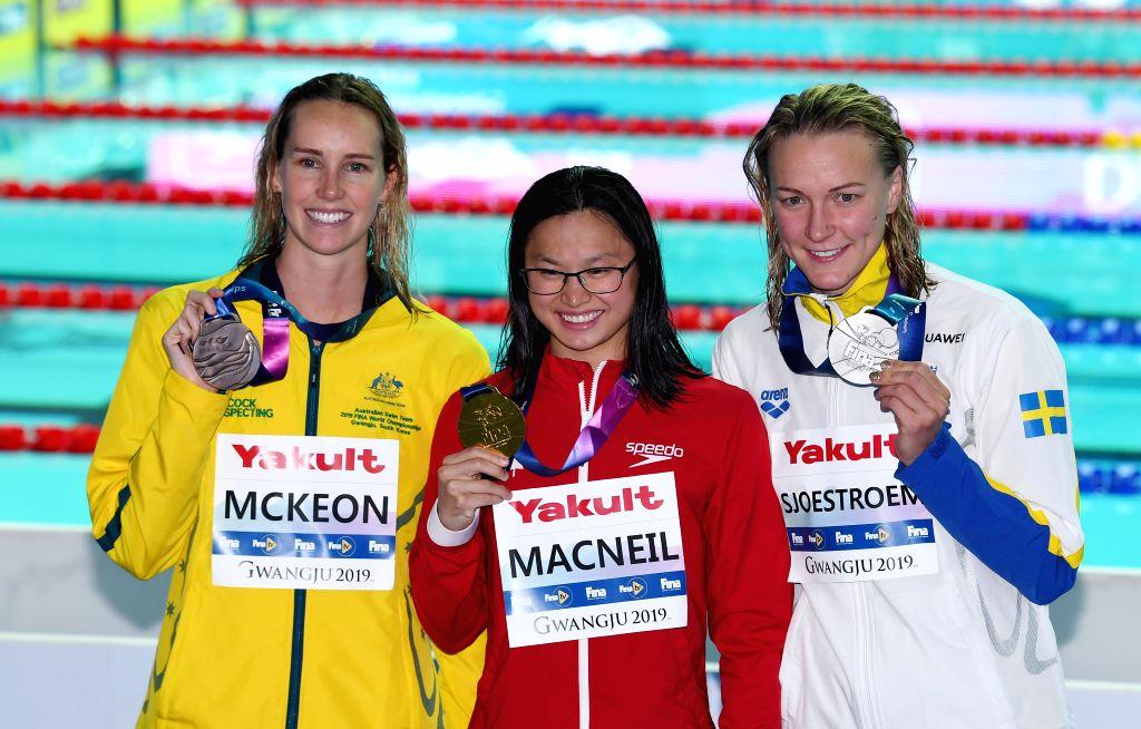 GWANGJU, July 22, 2019 - Gold medalist Margaret MacNeil (C) of Canada, silver medalist Sarah Sjoestroem (R) of Sweden and bronze medalist Emma McKeon of Australia pose after the awarding ceremony of ...