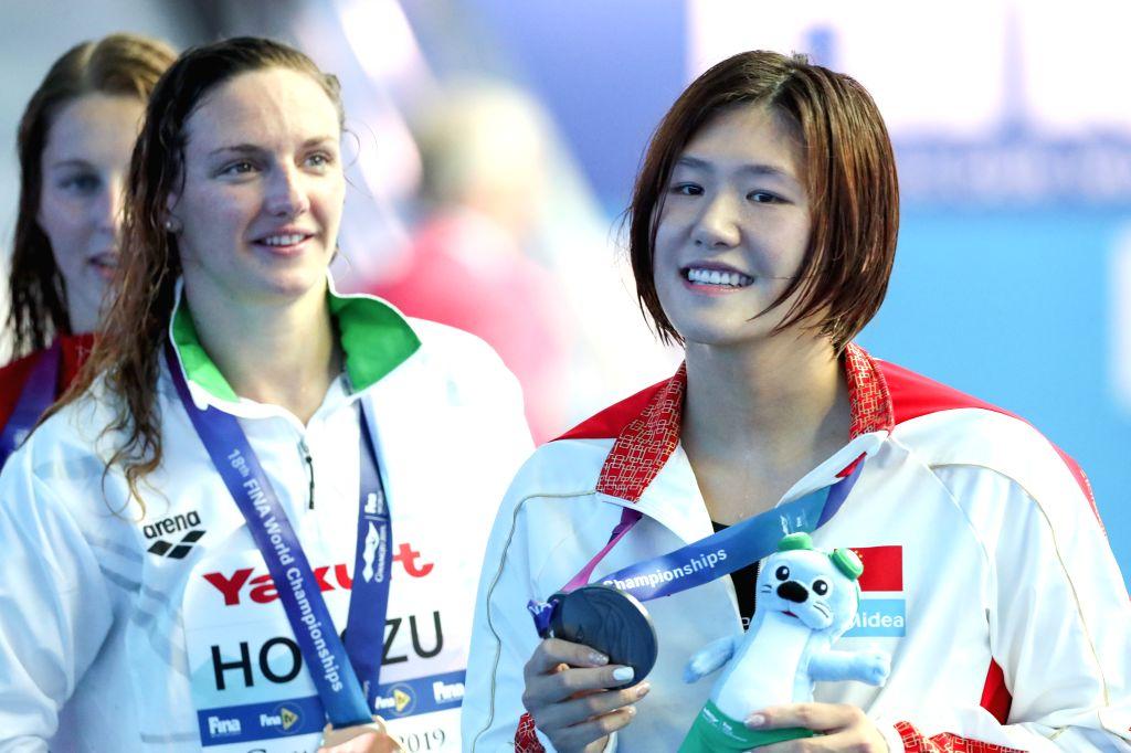 GWANGJU, July 22, 2019 - Silver medalist Ye Shiwen (R) of China is seen after the awarding ceremony of the women's 200m medley final at the Gwangju 2019 FINA World Championships in Gwangju, South ...
