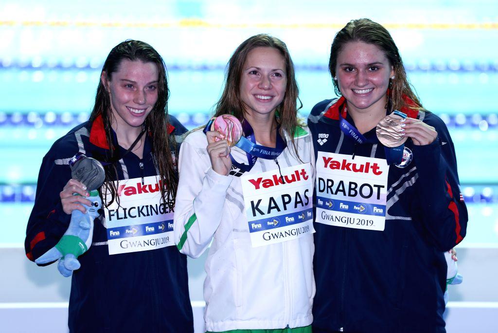 GWANGJU, July 25, 2019 - Gold medalist Boglarka Kapas (C) of Hungary, silver medalist Hali Flickinger (L) of the United States and bronze medalist Katie Drabot of the United States pose for photos ...
