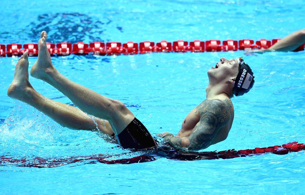 GWANGJU, July 25, 2019 - Gold medalist Caeleb Dressel of the United States celebrates after the men's 100m freestyle final at the Gwangju 2019 FINA World Championships in Gwangju, South Korea, July ...