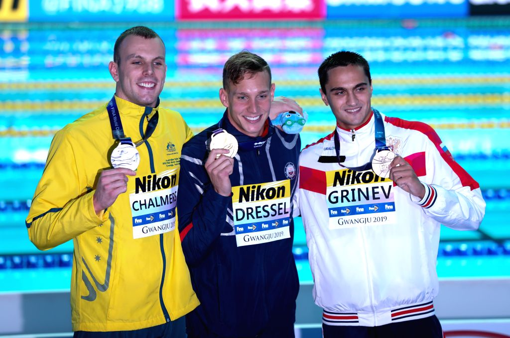 GWANGJU, July 25, 2019 - Gold medalist Caeleb Dressel (C) of the United States, silver medalist Kyle Chalmers (L) of Australia and bronze medalist Vladislav Grinev of Russia pose for photos after the ...