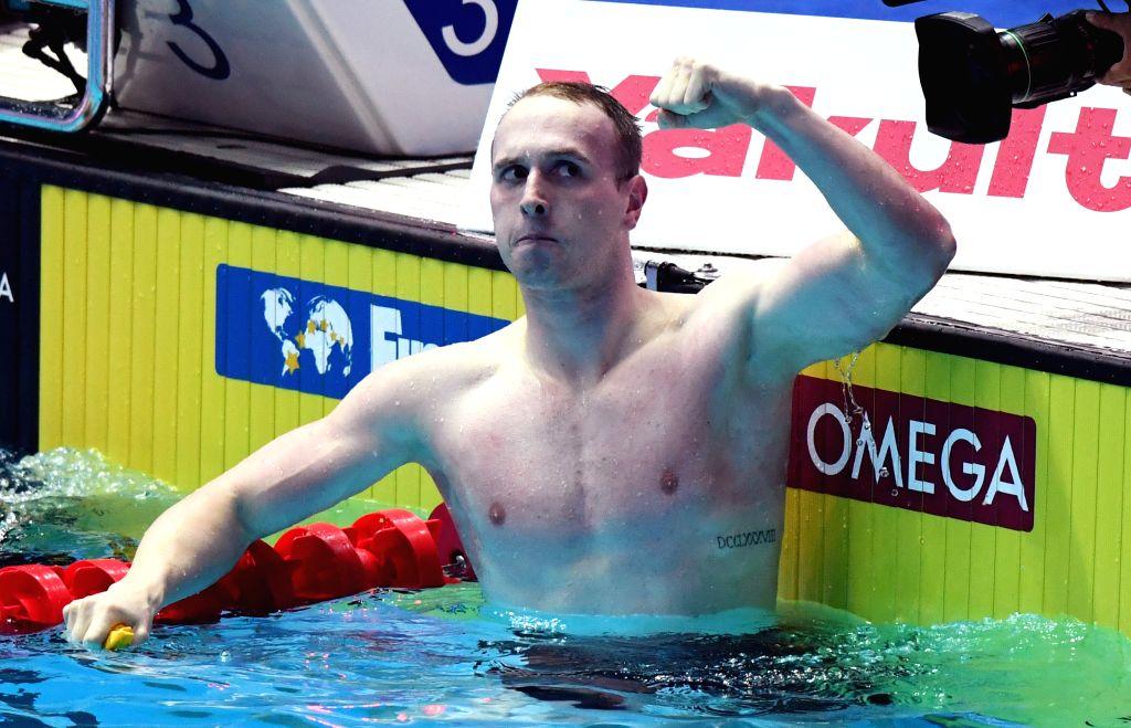GWANGJU, July 25, 2019 - Gold medalist Matthew Wilson of Australia celebrates after the men's 200m breaststroke semifinal at the Gwangju 2019 FINA World Championships in Gwangju, South Korea, July ...