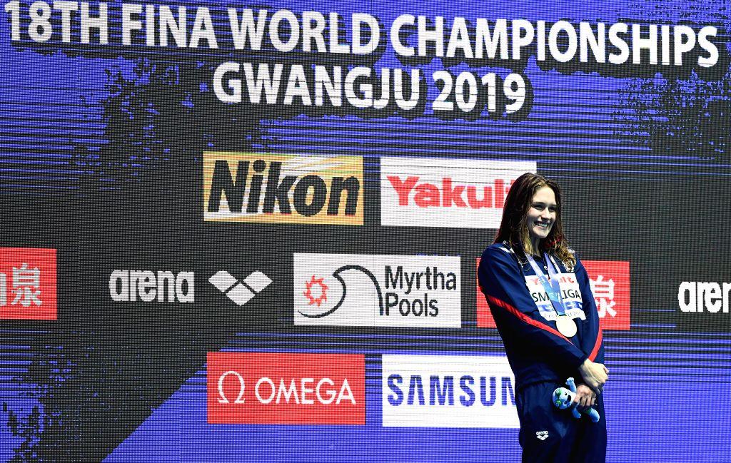 GWANGJU, July 25, 2019 - Gold medalist Olivia Smoliga of the United States poses during the awarding ceremony of the women's 50m backstroke final at the Gwangju 2019 FINA World Championships in ...
