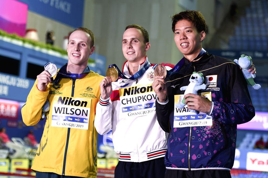 GWANGJU, July 26, 2019 - Gold medalist Anton Chupkov (C) of Russia, silver medalist Matthew Wilson (L) of Australia and bronze medalist Ippei Watanabe of Japan pose after the men's 200m breaststroke ...