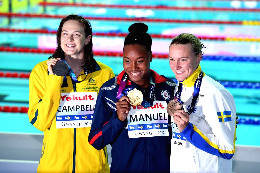 GWANGJU, July 26, 2019 - Gold medalist Simone Manuel (C) of the United States, silver medalist Cate Campbell (L) of Australia and bronze medalist Sarah Sjoestroem of Sweden pose after the women's ... - Cate Campbell