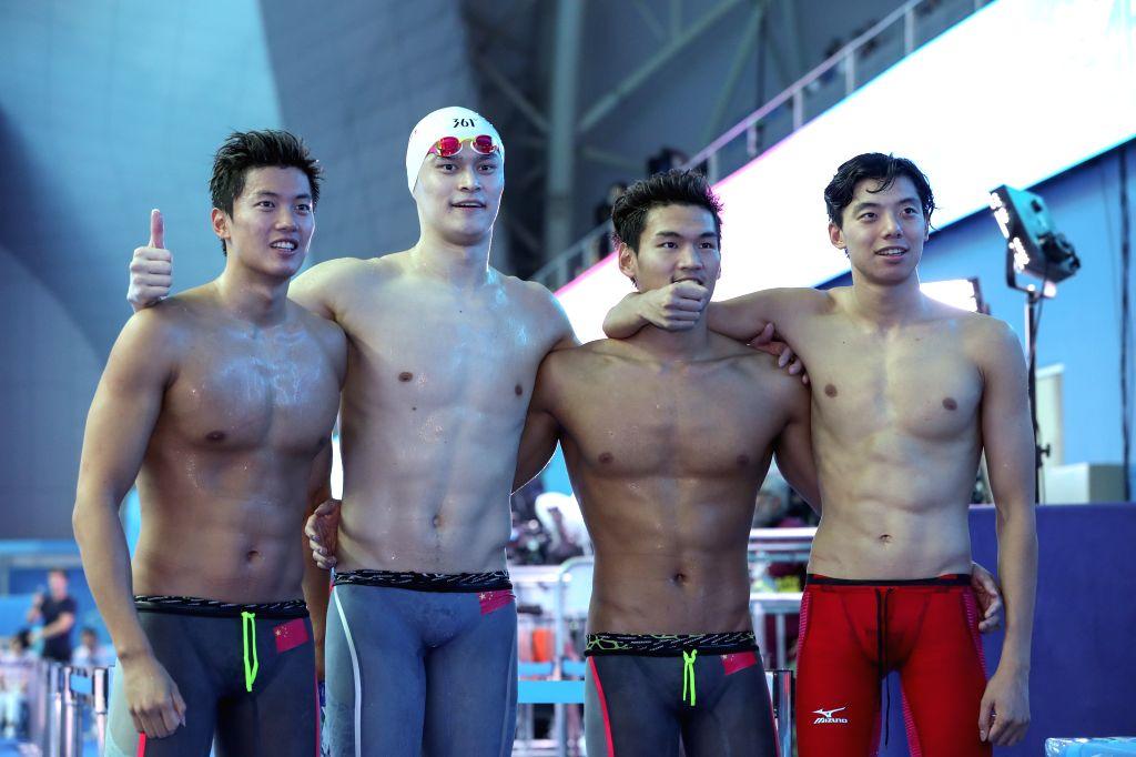 GWANGJU, July 26, 2019 - Wang Shun, Sun Yang, Xu Jiayu and Ji Xinjie (L to R) of China pose after the men's 4x200m freestyle relay final at FINA World Championships in Gwangju, South Korea, on July ...