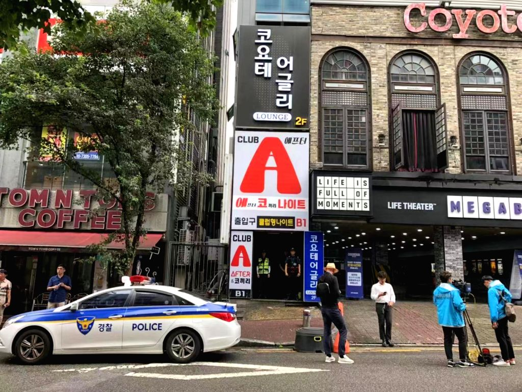 GWANGJU, July 27, 2019 - Journalists work outside the nightclub where a collapse incident happened in Gwangju, South Korea, July 27, 2019. The 18th FINA World Championships was ongoing in Gwangju and ...