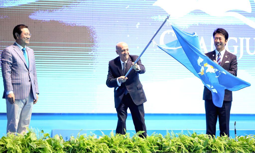 GWANGJU, July 28, 2019 - FINA President Julio Maglione (C) waves the flag of FINA during the closing ceremony of the Gwangju 2019 FINA World Championships in Gwangju, South Korea, July 28, 2019.